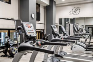 fitness center lined with treadmills