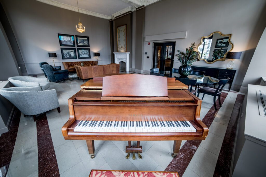 piano room centered by cherry-brown piano